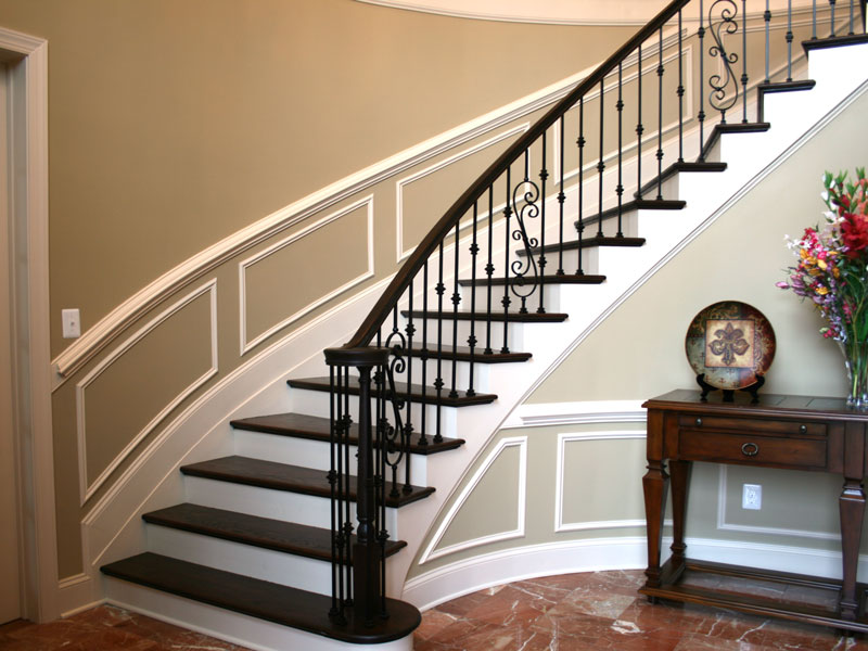 cregger construction home contractors curved wooden stair rails and metal spindles installed in baltimore maryland home near carroll county maryland