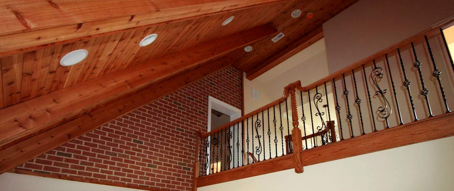 cregger construction home contractors upstairs wooden handrails and metal spindles installation for interior home improvement in carroll county home near baltimore maryland