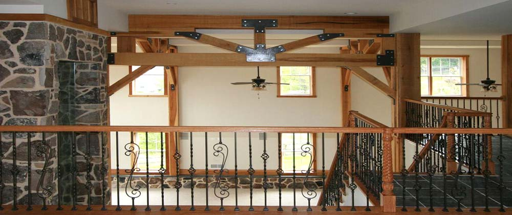 cregger construction home contractors interior home improvement with wooden handrail and metal spindle installed up stairs in carroll county maryland home near baltimore