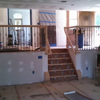 Stair and railing contractors at work