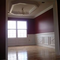Large room with wood floors