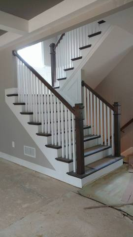 Home contractors remodeling wooden stair railing