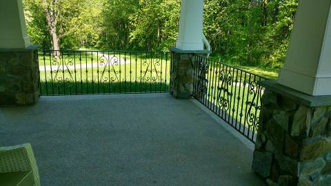 Front porch addition with iron railing