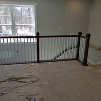Stair contractors remodeling a railing