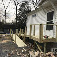 Home contractors building handicap-accessible railing