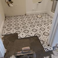 Home contractors remodeling bathroom floor