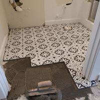 Home contractors remodeling bathroom floor