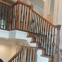 Stair railing remodel with wooden balusters