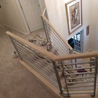 Home contractors remodeling railing on second floor