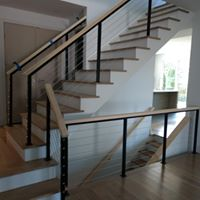 Home contractors remodeling a railing with a modern design