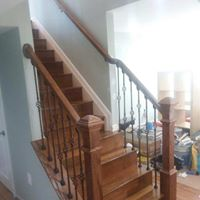Iron railing with wooden balusters