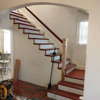 Stair contractors remodeling a staircase