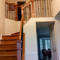 Wooden staircase with iron rungs