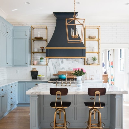 Powder blue kitchen with black and gold accents