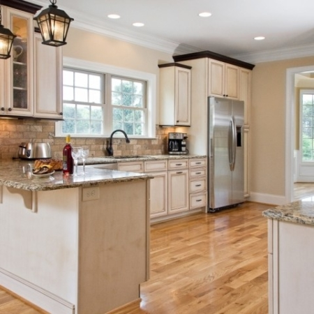 Kitchen design with wood floors and granite counters