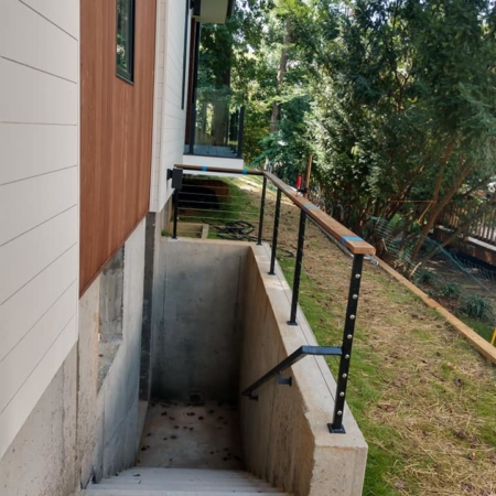 Outside railing to basement stairs