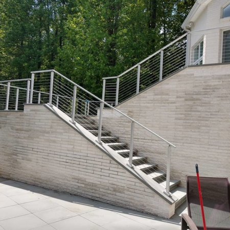 Deck addition with large staircase and metal railing