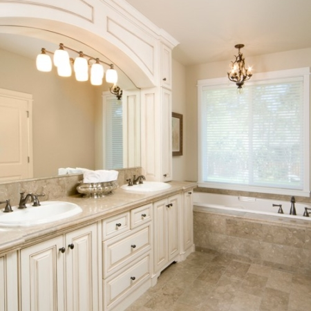 White cabinet and stone flooring bathroom remodel